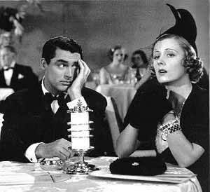 Irene Dunne and Cary Grant in the 1937 hit movie The Awful Truth. She wears a magnificent winged hat.